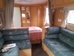 4 Berth ,Gas Cooker & Gas Electric Fridge Freezer 								<br>Gas Hot Water Service 								<br>Island Queen Bed East West 								<br>Seperate Large Shower, hand Basin & Cassette Toilet